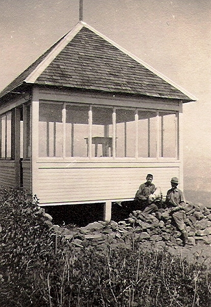 BenLomond lookout, This photo shows Butte Williams (with bulldog) and Jim Bader at the lookout in 1915, the year it was built. Williams was the first lookout. Note the firefinder inside the building.